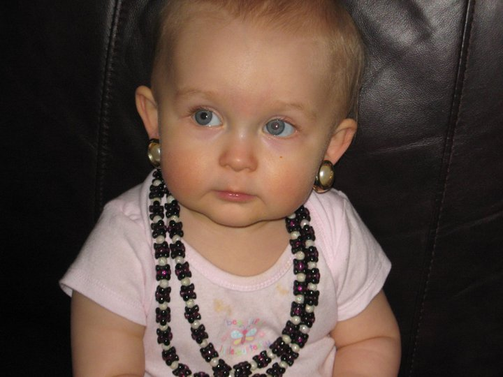 Daughter in Great-Grandmother's jewelry. Clip-on earrings were the bees knees :)